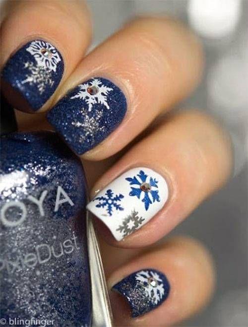 blue snowflake glitter nail design