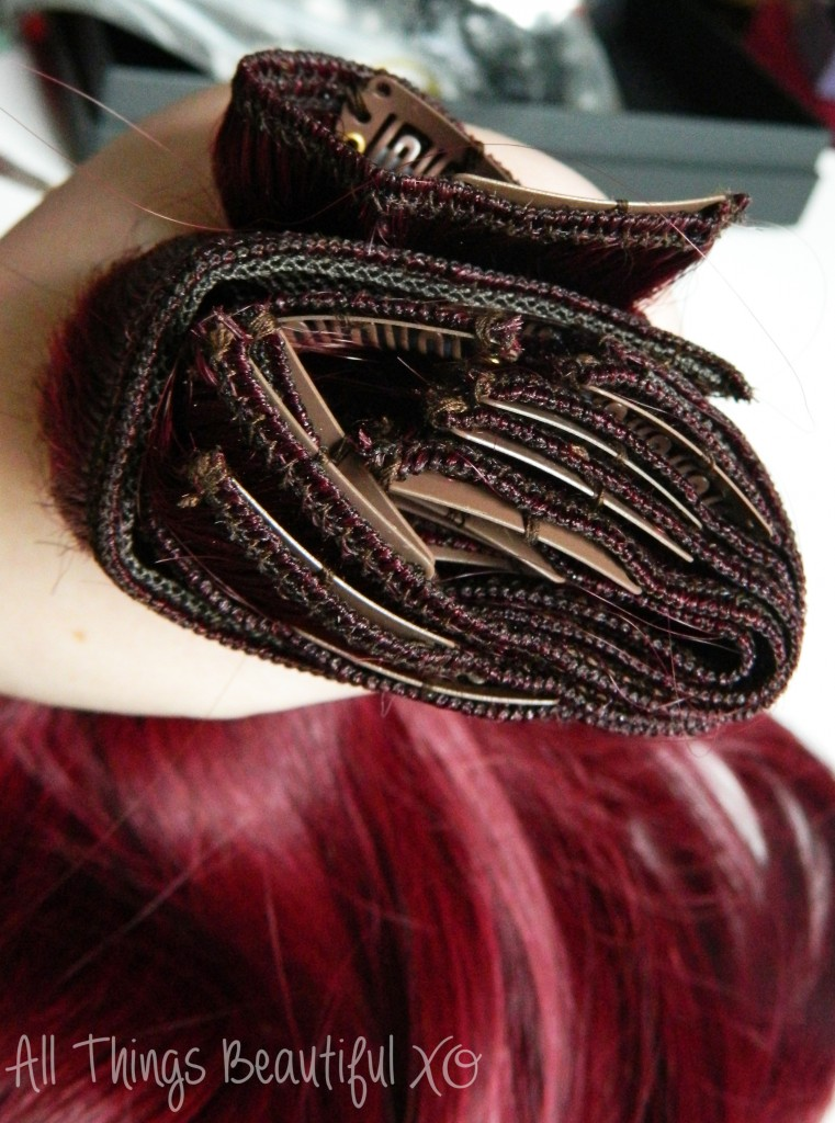 The Irresistible Me Silky Touch Clip-In Hair Extensions in Silky Rosewood- basically my favorite hair extensions ever! The Silky Touch extensions are 100% Remy human hair & are amazing quality. & you've got to see this burgundy red purple hair color! Check out my review + hairstyle demo on All Things Beautiful XO | www.allthingsbeautifulxo.com