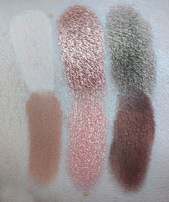 Swatches left to right of Butter London Eyeshadows in Linen, Quartz, Camo, Camel, Citrine, & Leather.  Swatches & review of the Butter London Shadow Clutch Palette in Natural Charm + the Interchangeable Duos in Fancy Flutter & Moody Blues. Customize it, primer infused, seriously pigmented & shadows that blend like a dream! Check it out on All Things Beautiful XO