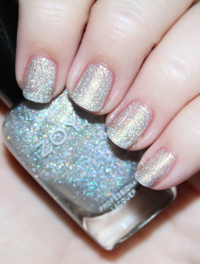 This is Zoya Alicia  Swatches & review of the Zoya Urban Grunge Metallic + Holos including the shades Alicia, Finley, Merida, Britta, Ash, & Troy! Check out more nail art, makeup reviews, & style on All Things Beautiful XO