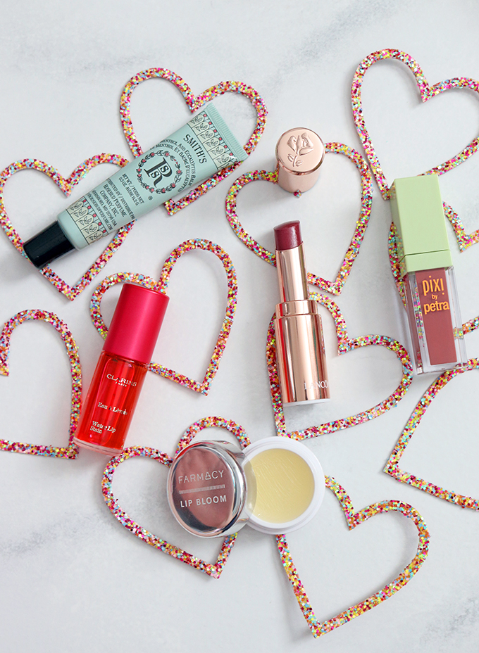Kissable, Wearable, & Personal Favorite Lip Products including the Pixi MatteLast Liquid Lipstick in Evening Rose, Smith's Rosebud Perfume Co., Farmacy lip Bloom, Clarins Water Lip Stain in Rose Water, & Lancome L'Absolu Mademoiselle Shine Lipstick in 398 Mademoiselle Loves Gifts for yourself, galentines, mom, or women in your life that AREN'T your regular box of chocolates or bouquet of flowers on All Things Beautiful XO