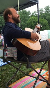 still life of man in repose with guitar
