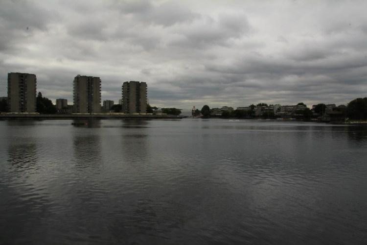 Dark water, distant towers