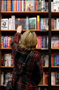 Reader selecting book photo