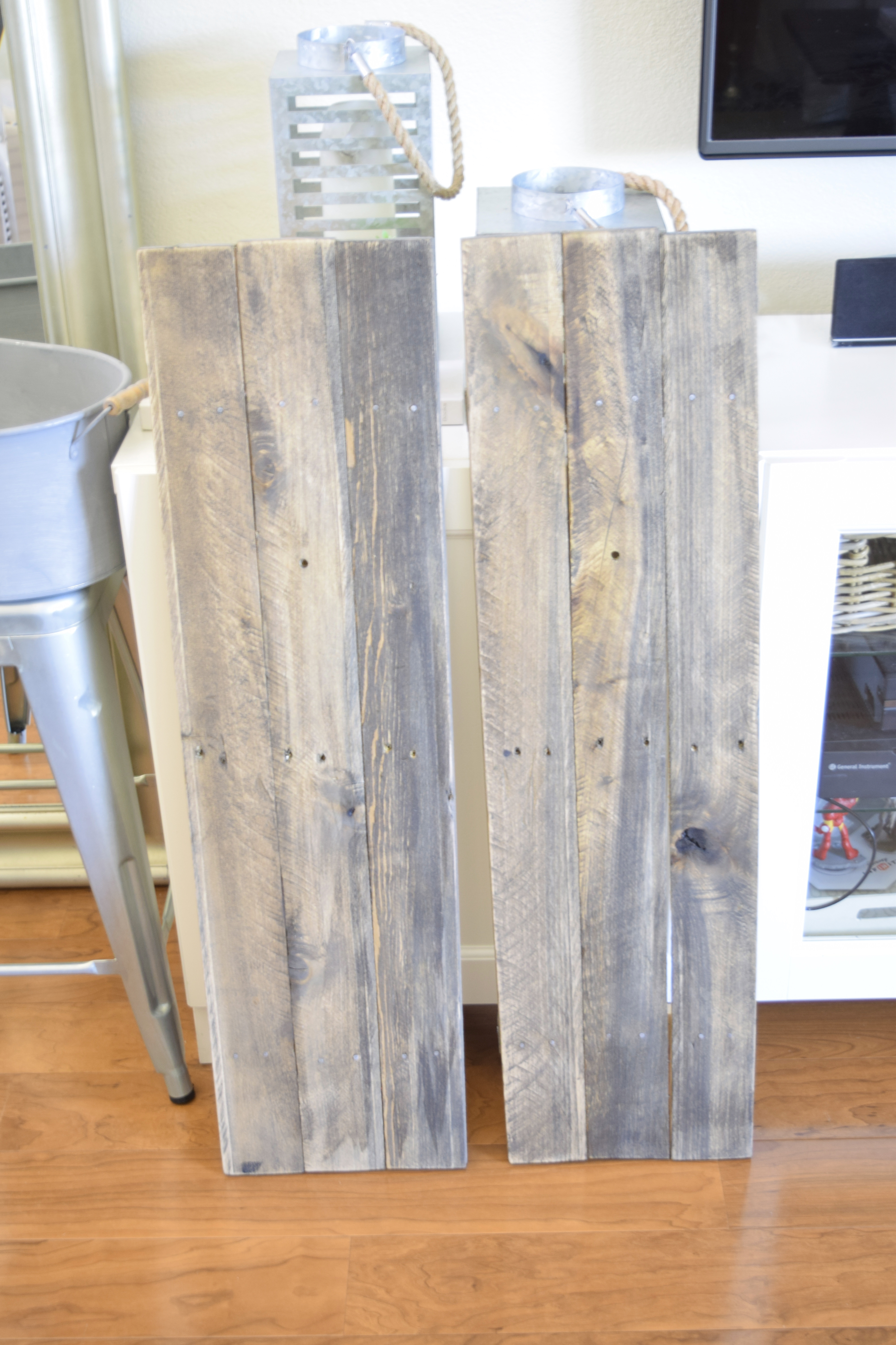 here, the pallets are stained, holes drilled, ready to apply wall lamp