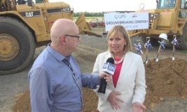 GlobeSt.com NJ editor Steve Lubetkin interviews NJ Lt. Gov. Kim Guadagno at the groundbreaking in Florence Township, NJ (Jake Kozmor Photo/StateBroadcastNews.com. Used by permission)