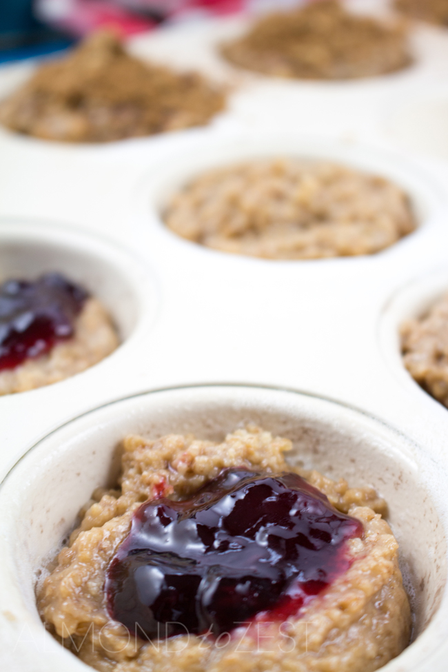 Whole-Wheat Jam Doughnut Muffins - A perfect way to start your morning these healthy layered muffins are bursting with flavor! Vegetarian too!!