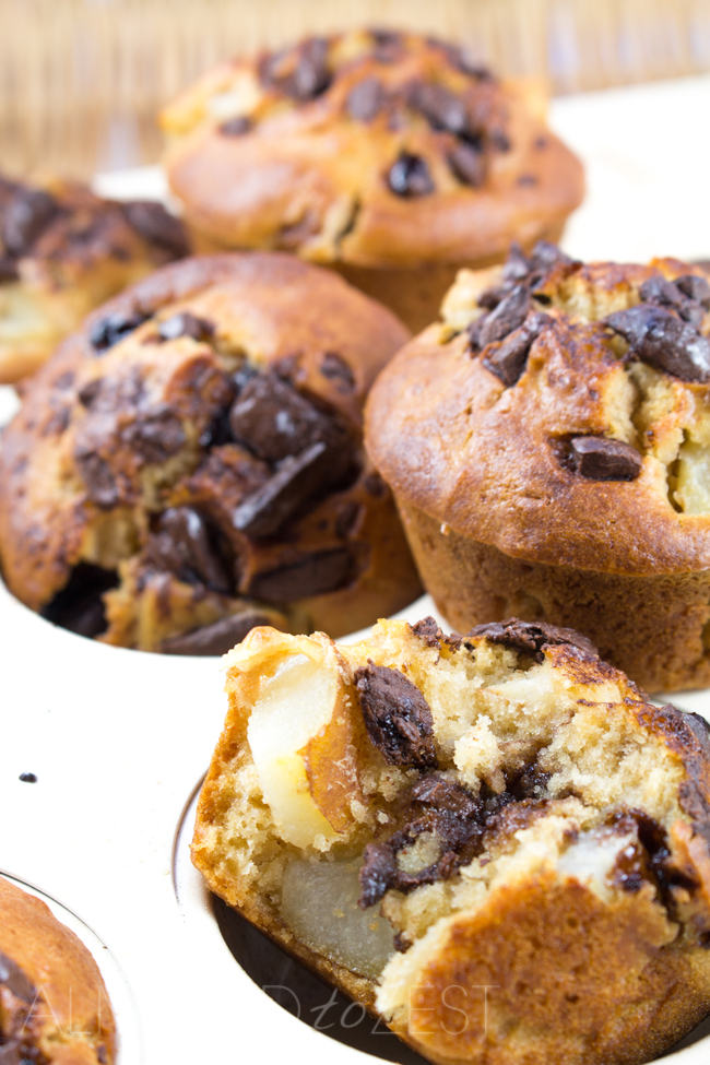 Pear, Ginger and Chocolate Muffins - This muffin recipe is fast and easy to make! Packed full of ginger, chocolate and juicy pear flavors that you're going to love!!