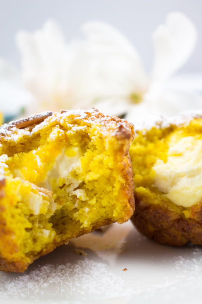 Orange and Cream Cheese Muffins - One of the BEST muffin recipes ever! Super soft, moist, zesty flavor with a glorious cream cheese center. Sooo YUM!!