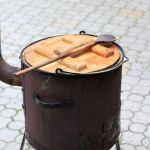 Cooking goulash in a cauldron