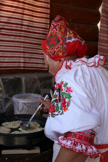 Slovak woman making potato pancakes