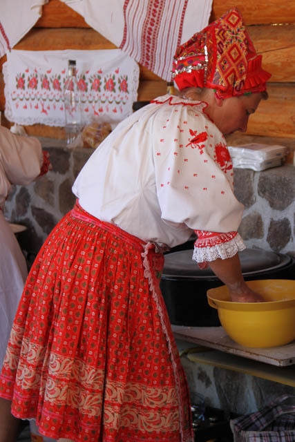 Mixing dough for trhane halusky in Helpa, Slovakia