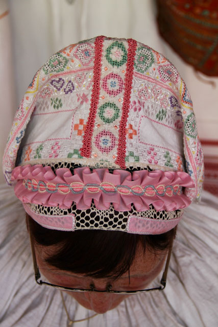 A Slovak woman shows her cap