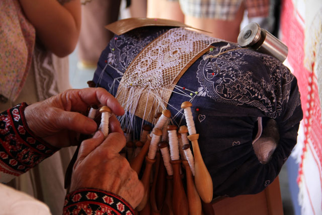 hands making Slovak lace