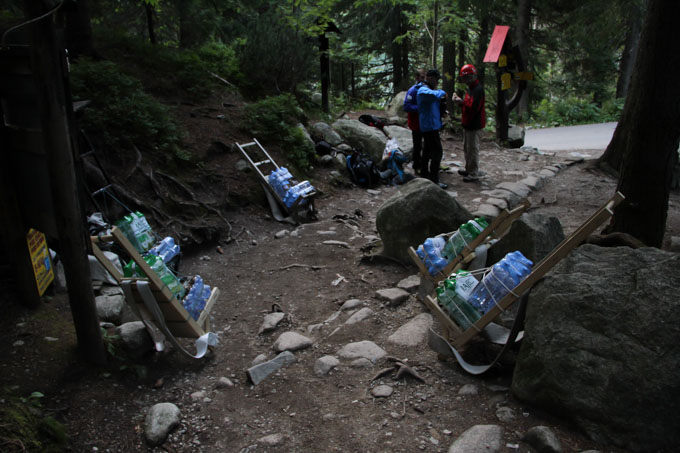 Packs waiting for volunteers to carry up to a mountain chalet