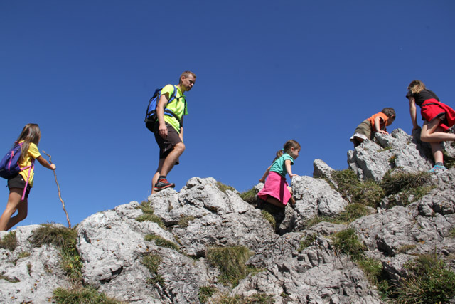 Children climbing on a rocky ledge