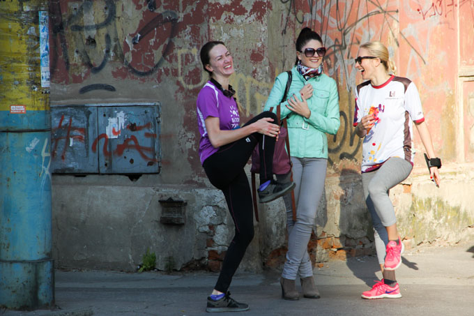 Young women laughing as they prepare for marathon