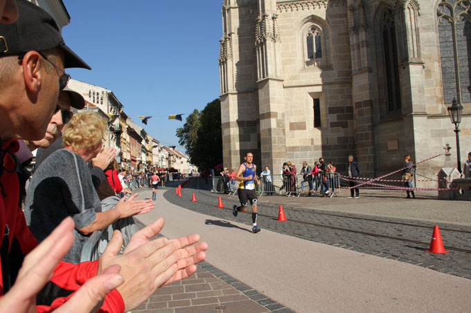 Clapping encourages runners at the Kosice Marathon