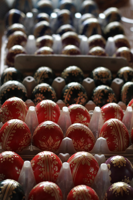 Straw decorated Easter eggs in cartons