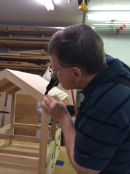 The shingles are glued and nailed like real shingles, hiding the nails.