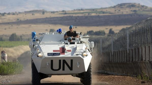 A United Nations (UN) peacekeeper vehicle make its way along the Israeli border with Syria next to the crossing of Quneitra between Syria to the Israeli annexed Golan Heights on June 12, 2013. AFP PHOTO/MENAHEM KAHANA        (Photo credit should read MENAHEM KAHANA/AFP/Getty Images)