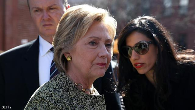 NEW YORK, NY - APRIL 17:  Democratic presidential candidate former Secretary of State Hillary Clinton (L) talks with aide Huma Abedin (R) before speaking at a neighborhood block party on April 17, 2016 in the Brooklyn borough of New York City. With two days to go before the New York presidential primary, Hillary Clinton is campaigning in and around New York City.  (Photo by Justin Sullivan/Getty Images)