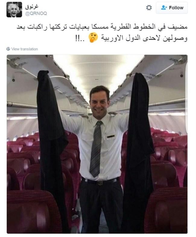 عباءات خليجيات في يد مضيف طيران تثير سخرية نشطاء تويتر وفيس بوك