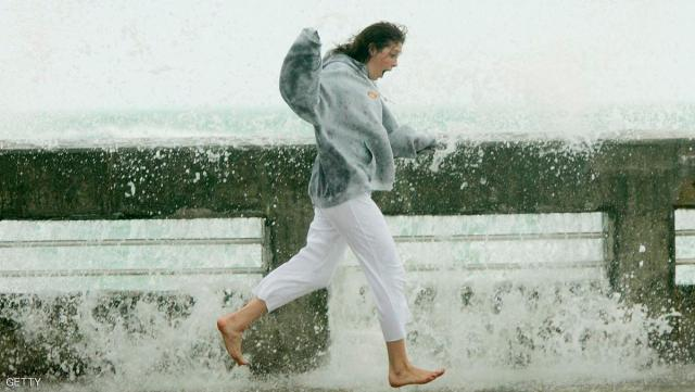 KEY WEST, FL - JULY 8:  Jenna Rose McCall runs along the side of a pier, dodging a crashing wave generated by the approaching Hurricane Dennis July 8, 2005 in Key West, Florida. Dennis hit central Cuba today after causing 18 deaths in Haiti and was on track for the U.S. coast through the Gulf of Mexico.  (Photo by Win McNamee/Getty Images)