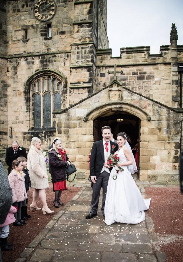 A bride and groom and friends outside St Michael's Church