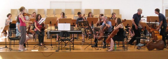 A photograph of an orchestra playing