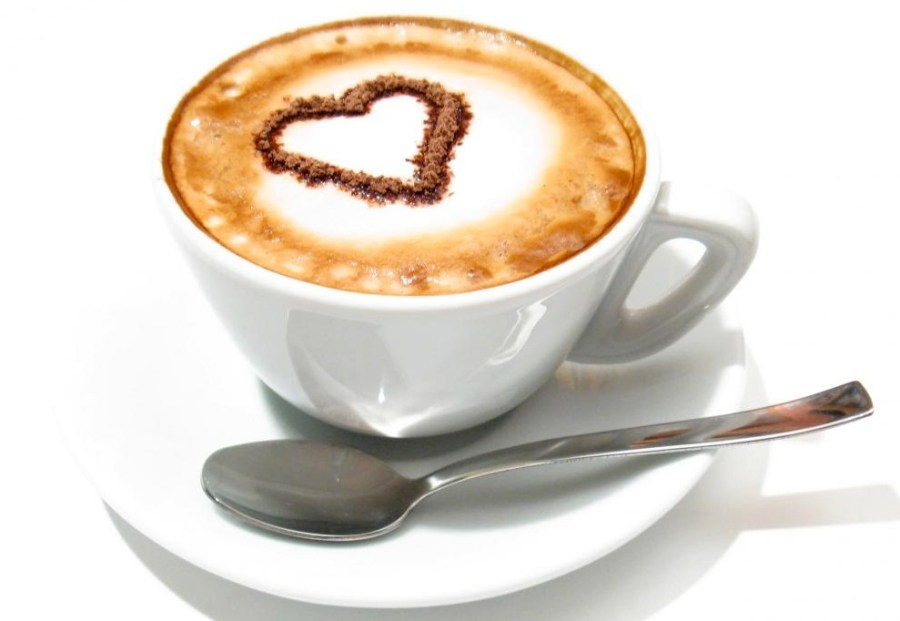 Photograph of a cup of coffee with a heart on it