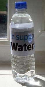 A bottle of water to be filled with coins in support of WaterAid