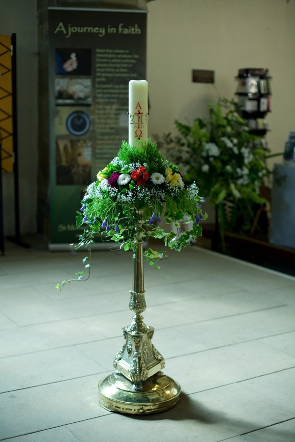 A flower-bedecked candle