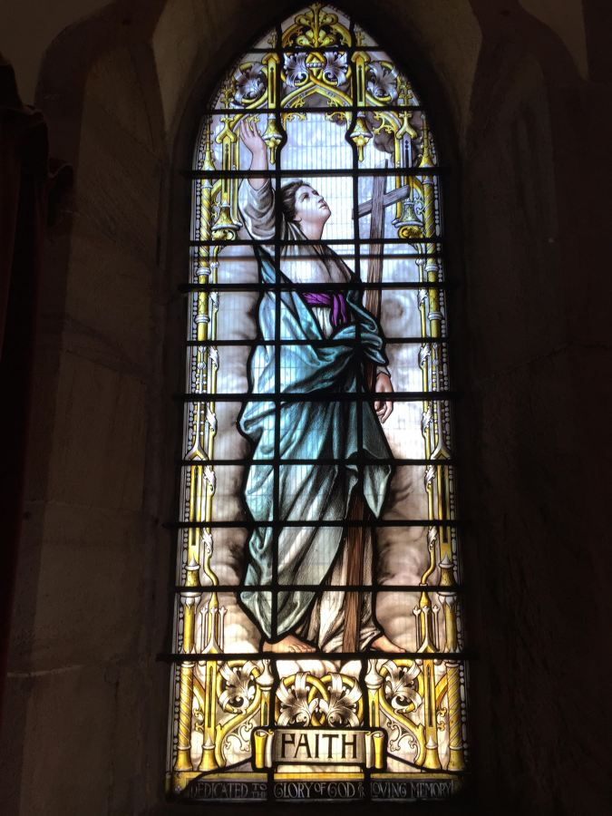 "Stained glass depiction of ""Faith"" at St Peter the Fisherman, Craster"
