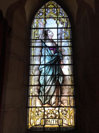 """Stained glass depiction of """"Faith"""" at St Peter the Fisherman, Craster"""