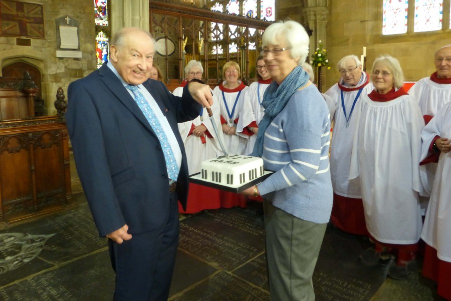 Organist Alan Hodgson, Churchwarden Jean Darby and members of the choir on the day of Alan's retirement