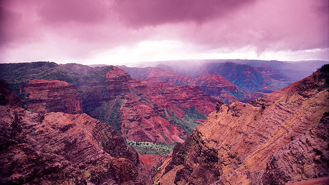 "Waimea Canyon, on the Hawaiian island of Kauai, is 10 miles long, a mile wide and about 3,600 feet deep. Mark Twain called it ""the Grand Canyon of the Pacific."""