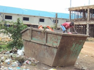 Street Children search for food in bins