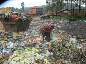 Boy picking food from refuse dump