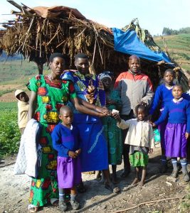 Gloria with her carers and pupils at GNMS at the hut she calls home