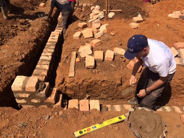 Laying of foundation brick