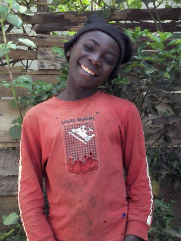 Young boy sponsored through primary education