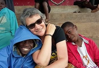 Aid woker with street children in Uganda