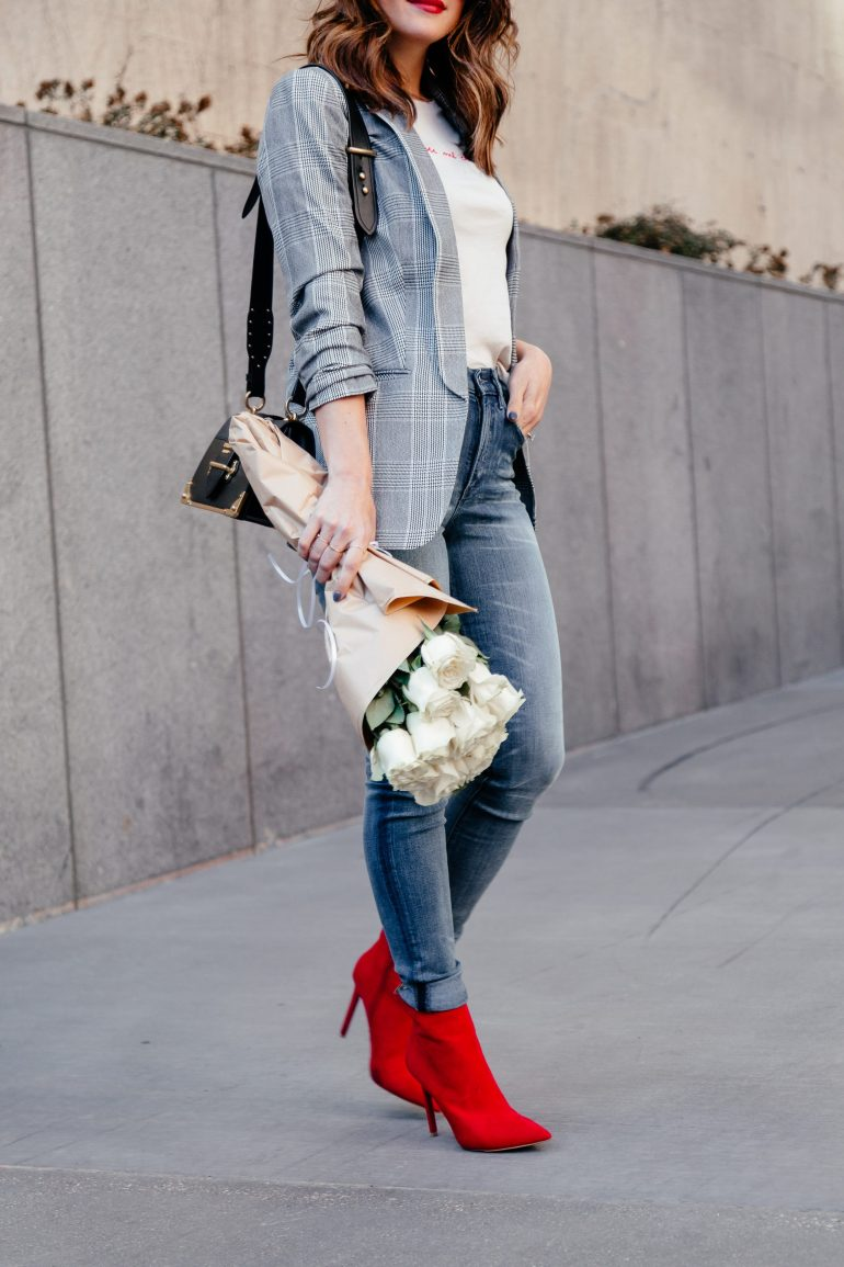 Valentine's Day Dressing: Sharing VDay outfit ideas with Express. Click through to shop tons of cute options no matter what your plans are! #ExpressPartner #ValentinesDay #GraphicTshirt #DateNightStyle #RedBooties