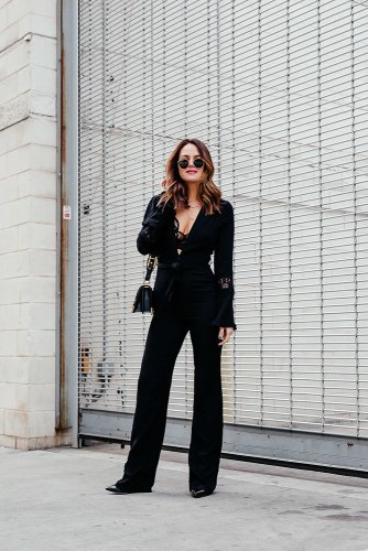 Sassy Black Jumpsuit: Dallas blogger sharing a long sleeve black jumpsuit with bell sleeves and a flared leg for a fun date night look in honor of finishing another Whole 30. #jumpsuit #blackjumpsuit #stonecoldfox #fashion #ootd