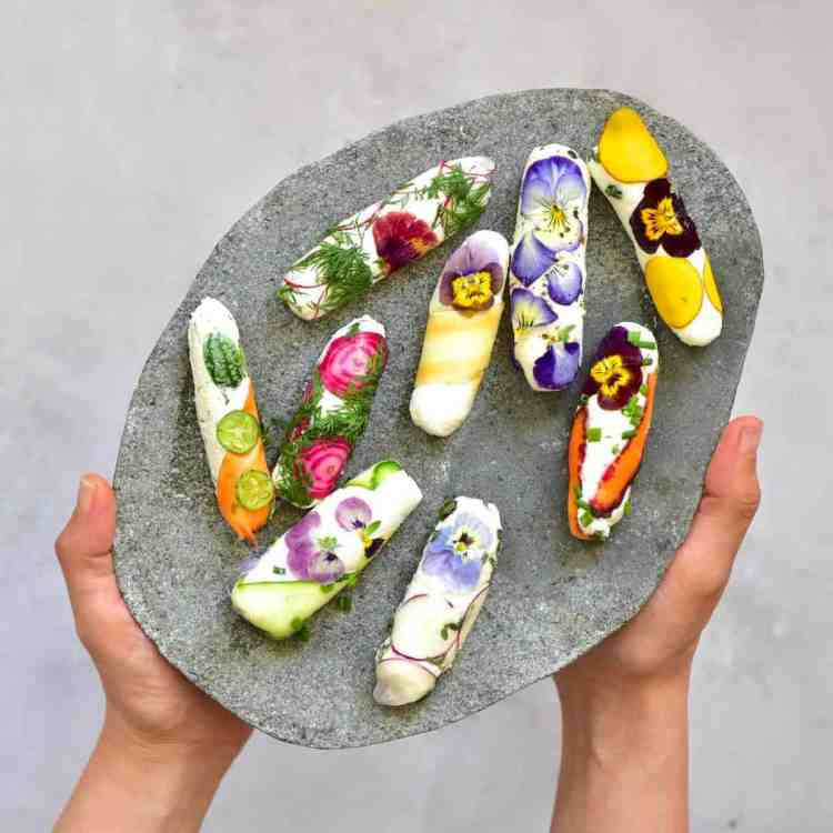 Simple Rainbow Goat Cheese Rolls with edible flowers. Perfect appetizer for party, cheeseboard and vegetarian bbq recipe