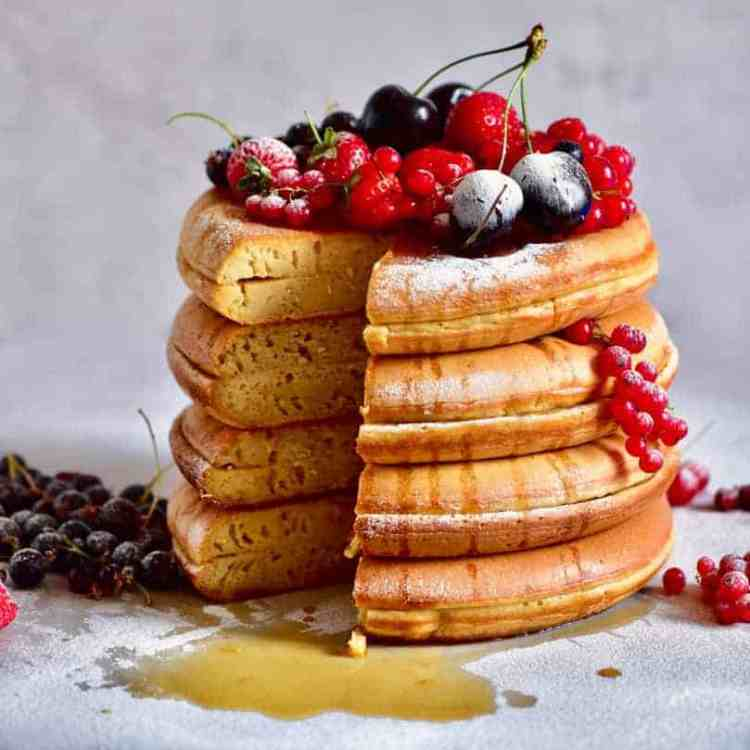 thick, fluffy japanese style pancakes with fresh berries. Refined sugar free