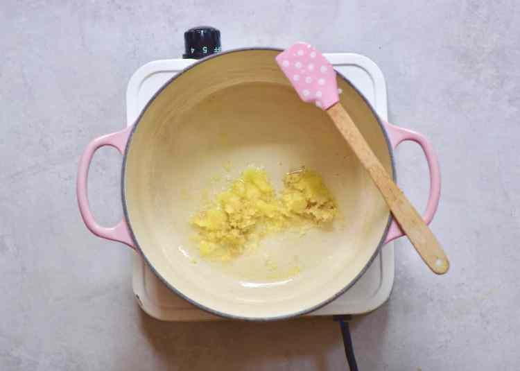 crushing garlic and ginger for vegan pumpkin soup