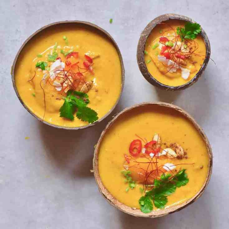 This Delicious coconut curry pumpkin soup uses just 15 ingredients and is a great easy pumpkin recipe for using up your leftover pumpkins. Plus, is 100% vegan and a delicious winter warming recipe! Plus this recipe uses delicious homemade 2-ingredient coconut milk and pumpkin puree ( but don't worry, you can also use store-bought coconut milk, if you'd prefer!)