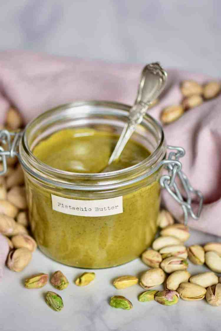 two-ingredient Homemade pistachio butter recipe with pistachio butter uses. Perfect for a DIY holiday gift and Edible Christmas gift